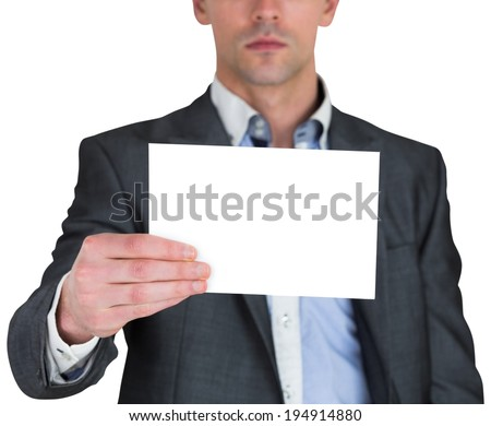 Businessman in grey suit showing card on white background