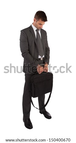 Businessman in handcuffs holding briefcase isolated on white - stock photo