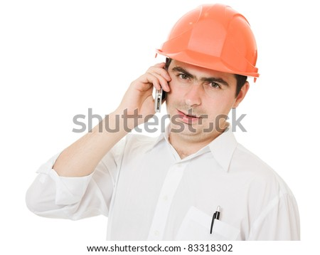Businessman in helmet on the phone.