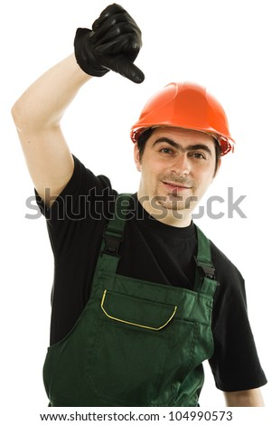 Businessman in helmet pointing down on a white background.