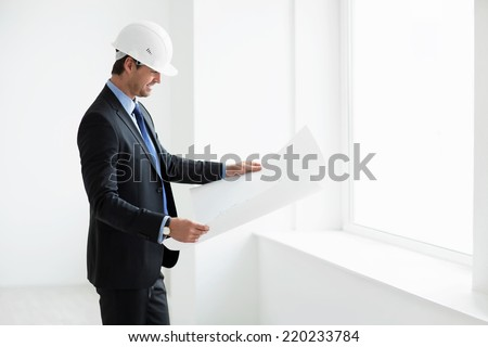 Businessman in helmet with the project