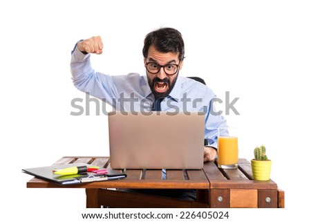 Businessman in his office giving punch over white background   - stock photo