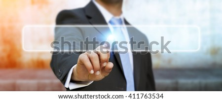 Businessman in his office pushing digital tactile button
