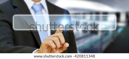 Businessman in his office pushing digital tactile button - stock photo