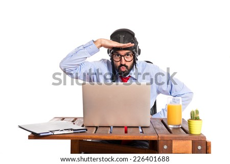 Businessman in his office with pilot hat