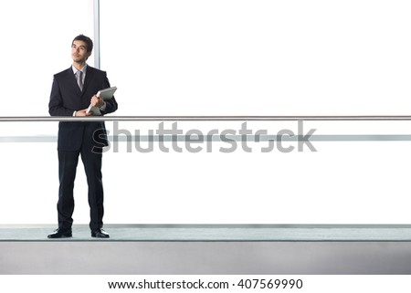 Businessman in modern office building - stock photo