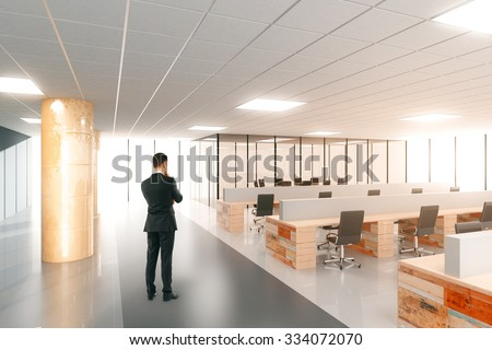 Businessman in modern open space office with furniture 3D Render - stock photo
