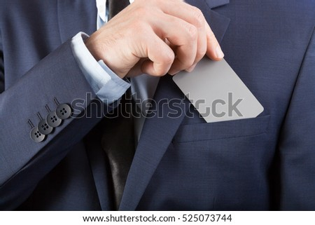 Businessman in neat suit holding blank card with YOUR TEXT OR IMAGE