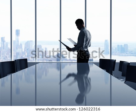 businessman in office and city in window