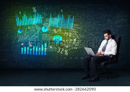 Businessman in office chair with laptop in hand and high tech graph charts concept on background - stock photo