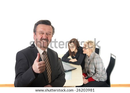 Businessman in office environment. Three people with focus on mature boss in front. Isolated over white.