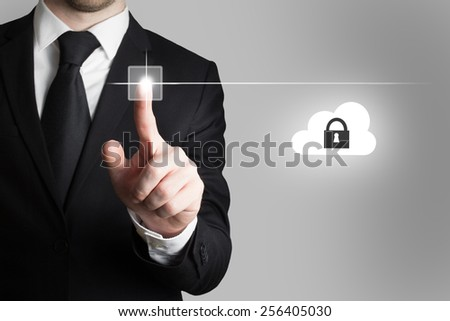 businessman in office pressing touchscreen button cloud security - stock photo