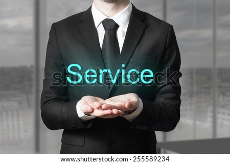 businessman in office serving gesture service - stock photo