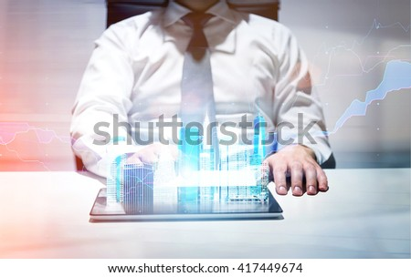 Businessman in office using tablet with New York city gologram and business chart - stock photo