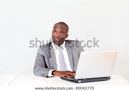 Businessman in office with thoughtful look