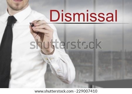 businessman in office writing dismissal in the air - stock photo