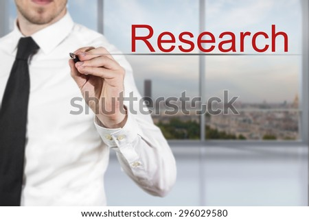 businessman in office writing research in the air - stock photo