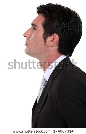 Businessman in profile - stock photo