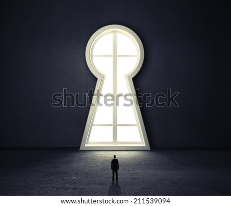 businessman in room looking to window if form  keyhole - stock photo
