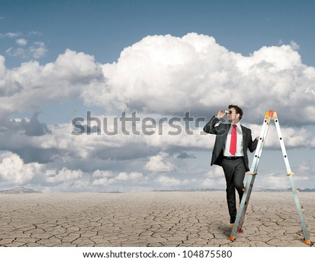 Businessman in search of business in a desert - stock photo
