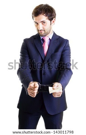 Businessman in shackles paying a bribe white background. Conceptual image. - stock photo