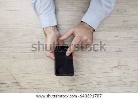 Businessman in shirt and jacket with phone and tablet
