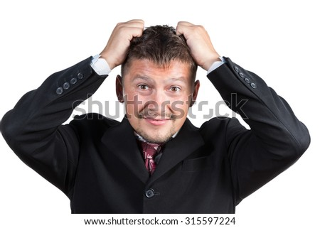 Businessman in suit and tie expressing negative emotions tearing at her hair isolated on white background