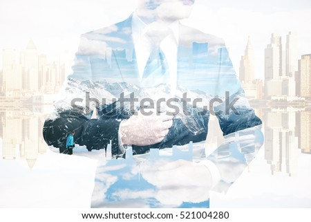 Businessman in suit and tie on abstract city and snowy mountains background. Research concept. Double exposure