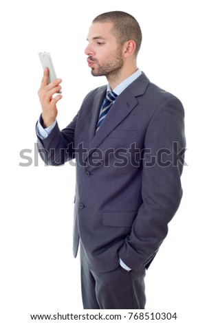 businessman in suit and tie taking selfie photo with mobile phone camera posing happy and successful isolated on white background