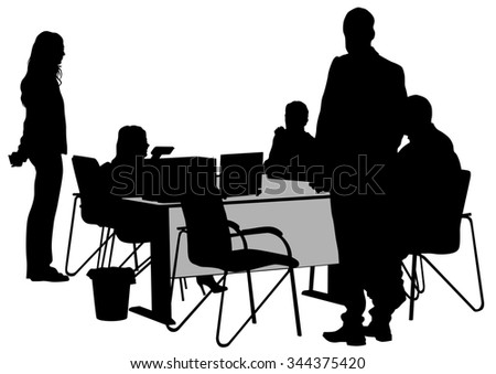 Businessman in suit at table on white background - stock photo