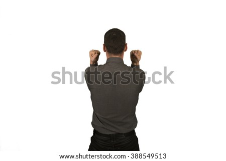 Businessman in suit backwards with a winner gesture
