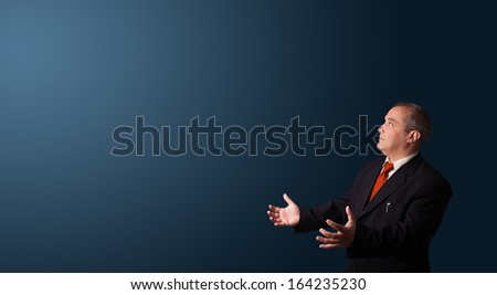 businessman in suit gesturing with copy space - stock photo