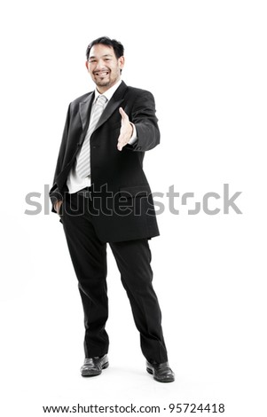 Businessman in suit giving an hand for handshake to seal the deal - stock photo