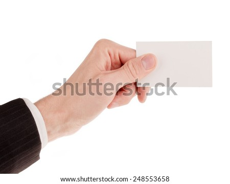 Businessman in suit holding a blank business card isolated on white
