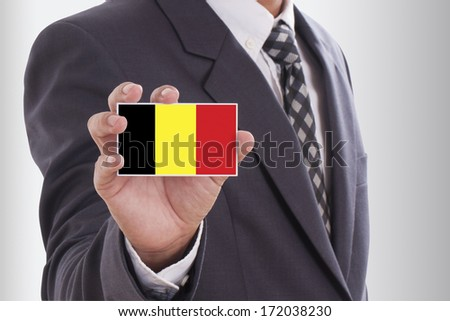 Businessman suit holding business card belgium stock photo royalty businessman in suit holding a business card with belgium flag reheart Choice Image