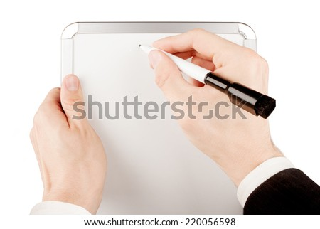 Businessman in suit holding and writing on empty whiteboard isolated on white