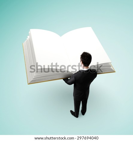 businessman in suit holding big book - stock photo