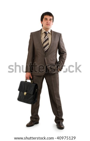 Businessman in suit holding briefcase. Isolated over white background