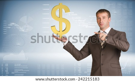 Businessman in suit holding dollar sign. Graphs and texts as backdrop