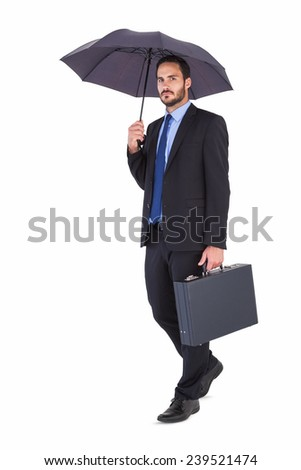 Businessman in suit holding umbrella and briefcase on white background