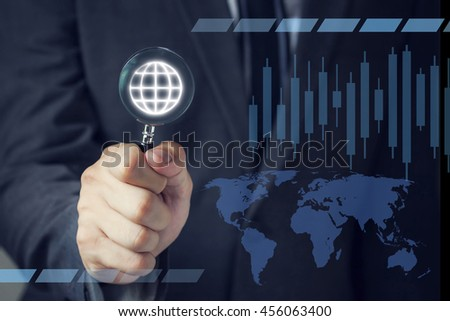Businessman in suit looking for virtual world using a small magnifier. - stock photo