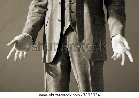 businessman in suit making gesture with arms, sepia toned