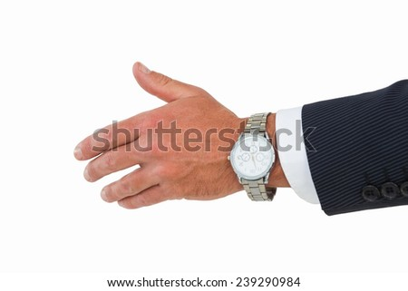 Businessman in suit offering handshake on white background - stock photo