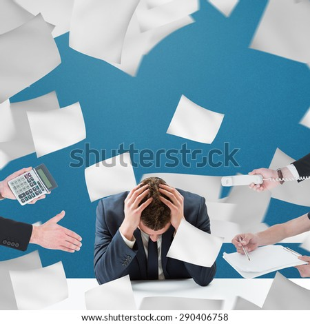 Businessman in suit offering his hand against blue background - stock photo