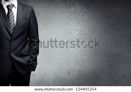 businessman in suit on a concrete background - stock photo