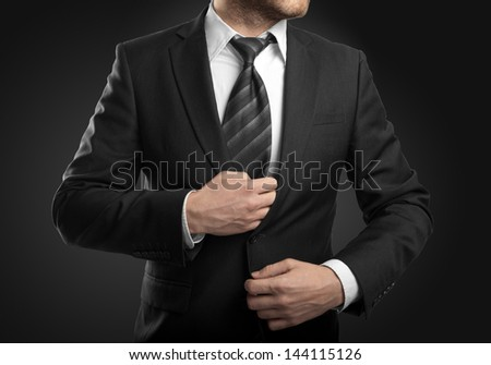 businessman in suit  on black background