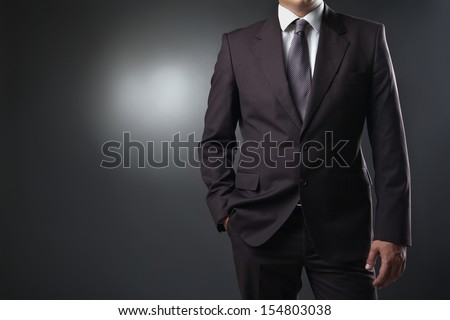 businessman in suit on gray background - stock photo