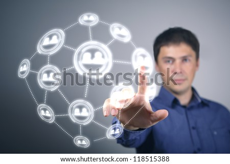 Businessman in suit pressing social media icon