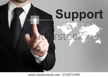 businessman in suit pushing button support worldmap international - stock photo