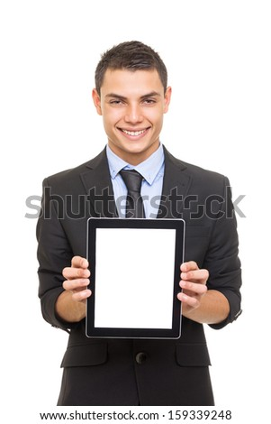 Businessman in suit showing blank tablet computer screen - stock photo